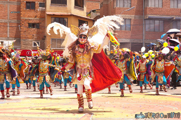 Bolivia a different country: The angel San Gabriel commands one of the devils in the carnival of Oruro.